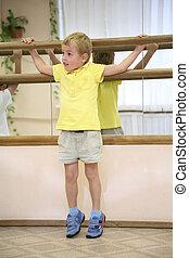 little boy in sporthall