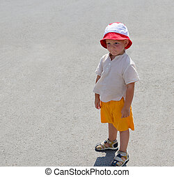Little boy in sunhat on the beach