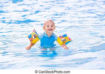 Little boy in swimming pool