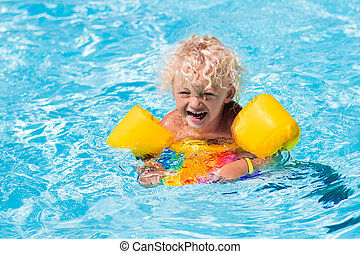 Little boy in swimming pool - Happy laughing little boy...
