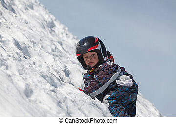 little boy in the Austrian Alps