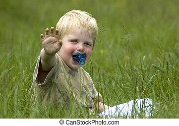 Little boy in the grass