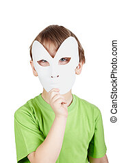 Little boy in the green t-shirt hides his face behind the...