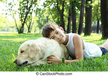 Little boy in the park with a dog