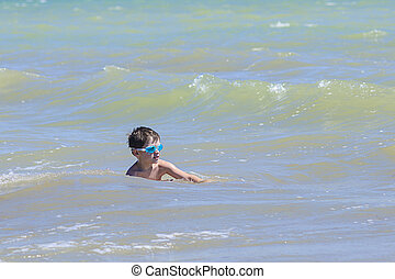 Little boy in the sea water