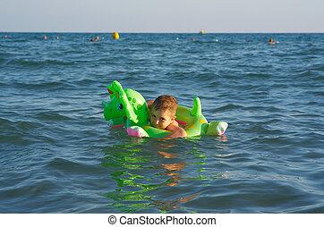 Little boy in the waves