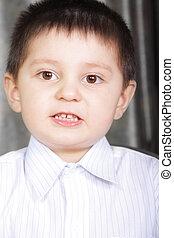 Little boy in white shirt