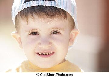 Little boy in yellow shirt