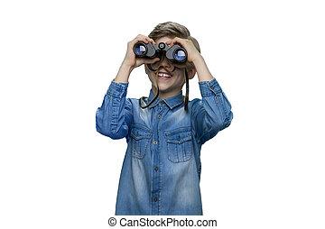 Little boy is looking through binoculars.