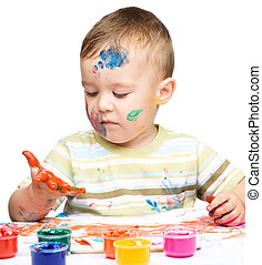 Little boy is playing with paints - Portrait of a cute ...