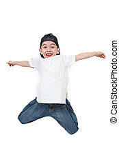 Little boy jumping on isolated white background