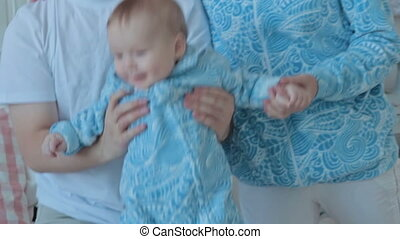 Little boy jumping on the bed