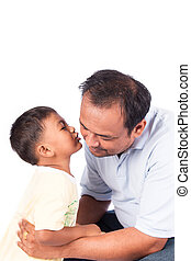 little boy kiss father