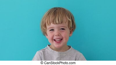 Little boy laughing at camera