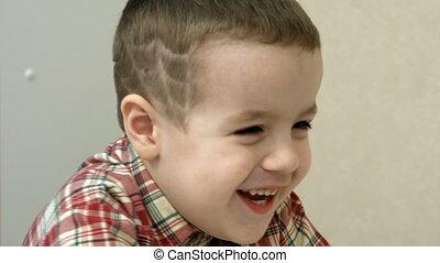 Little boy laughing closeup