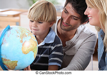 Little boy learning about the world with the help of his...