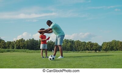 Little boy learning rules of football in nature - Cheerful ...