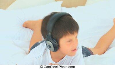 Little boy listening music