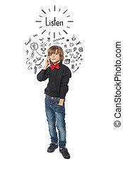 Little boy listens story on phone