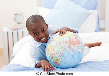 Little boy looking at a Globe