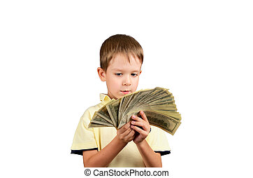little boy looking at a stack of 100 US dollars bills and think