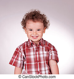 little boy looking at the camera and smiling