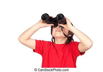 Little boy looking through binoculars