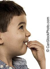 little boy looks uncertain symbol of childhood innocence,...