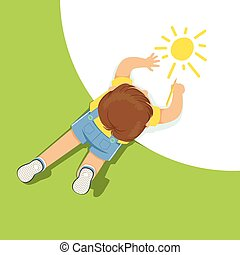 Little boy lying on floor and drawing sun using pencil, top view of child on the floor