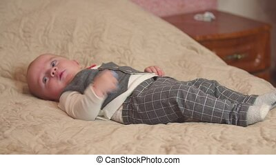 little boy lying on the bed