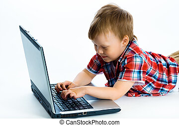boy lying on the floor with a laptop