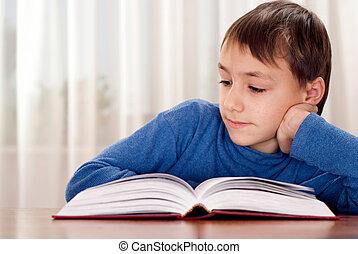 Little boy makes homework