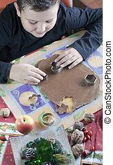 Little boy making christmas cookies