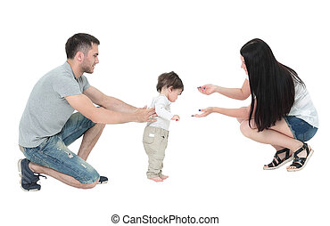 little boy making first steps with the help of parents -...