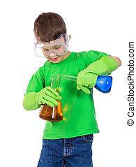 Little boy mixing a chemical liquids