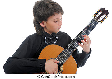Little boy musician playing guitar