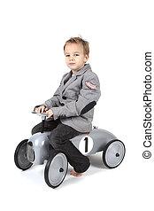 Little boy on a car