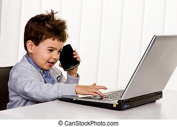 little boy on a laptop, symbol of the internet, e-commerce,...
