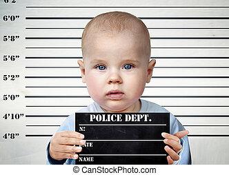 Little boy on a prison board - Little infant on a prison...