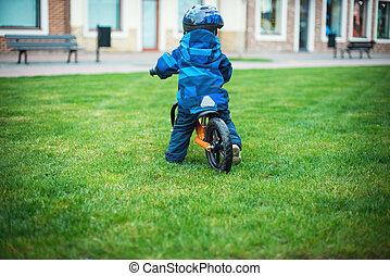 Little boy on a runbike