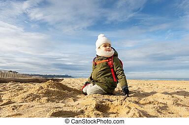 Little boy on beach, winter season