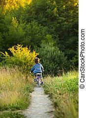 Little boy on bike