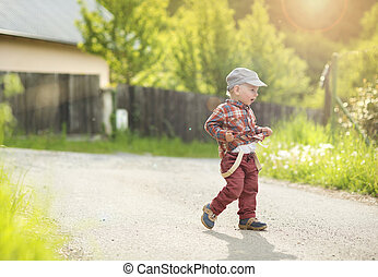 Little boy on coutryside road