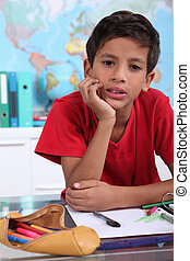 little boy on his school desk
