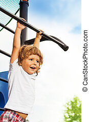 Little boy on horizontal bar