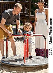 Little boy on merry-go-round - Little boy plying on...