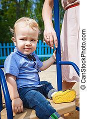 little boy on swing