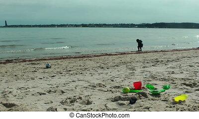 Little boy on the beach having fun