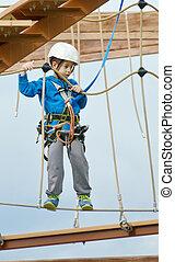 Little boy on the roap course sky trail