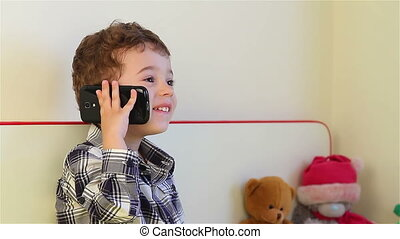 Little boy on the smartphone - Smiling little boy talking on...